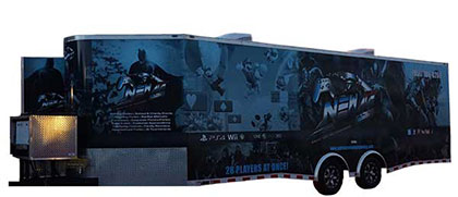 The New Age Gaming game trailer, this is a large blue trailer with video game charecters on the outside.