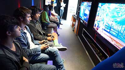 The Interior of the new age gaming game truck with guests playing video games in riverside